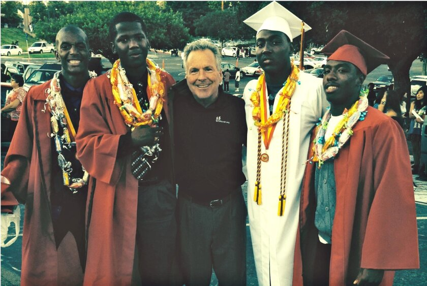 Craig McClain with some of his Boys to Men protégés, now in college with scholarships