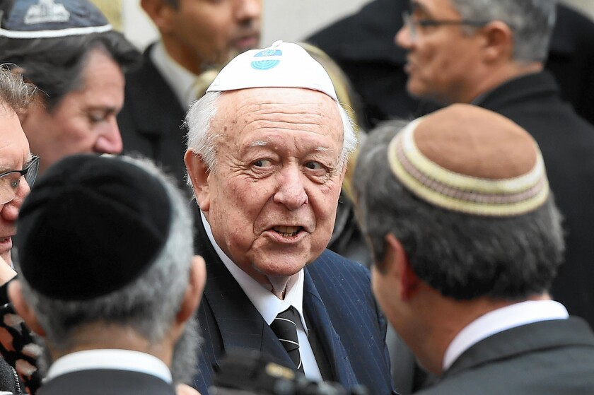 Jean-Claude Gaudin, mayor of Marseille, speaks with members of the Jewish community in the city's main synagogue after an attack on a Jewish teacher.