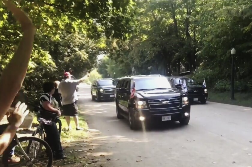 In this Saturday, Sept. 21, 2019, image made from video, Vice President Mike Pence leaves the Grand Hotel in an eight-vehicle motorcade on Mackinac Island, Mich. Pence scored a first when he took the motorcade to a speech on Michigan's picturesque Mackinac Island, drawing some criticism on social media. (Paul Egan/Detroit Free Press via AP)