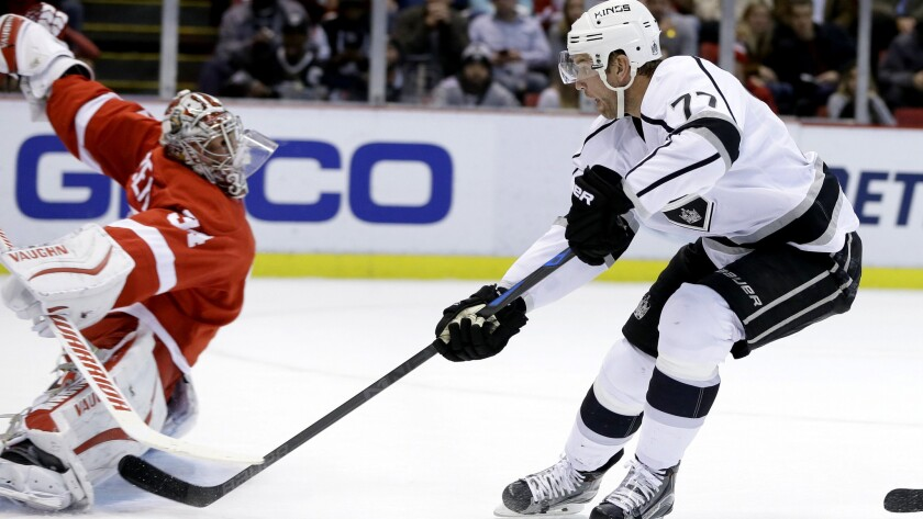 Kings center Jeff Carter (77) lifts a shotover the glove of Red Wings goalie Petr Mrazekto score in the first period Friday night in Detroit.