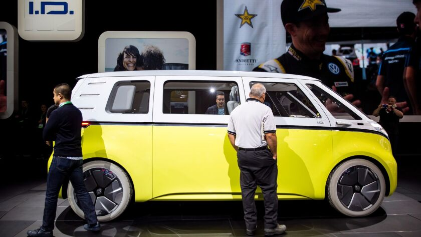 """LOS ANGELES, CA - NOVEMBER 30: People look at the Volkswgen ID Buzz concept vehicle at """"Automobility"""