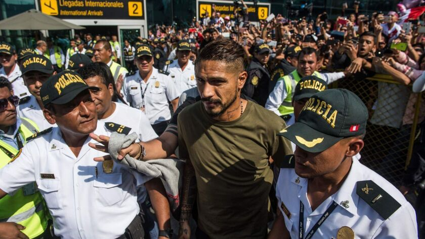 Peruvian football star Paolo Guerrero at an airport in Lima on Monday, a day after the Court of Arbitration for Sport extended a doping ban imposed on him.