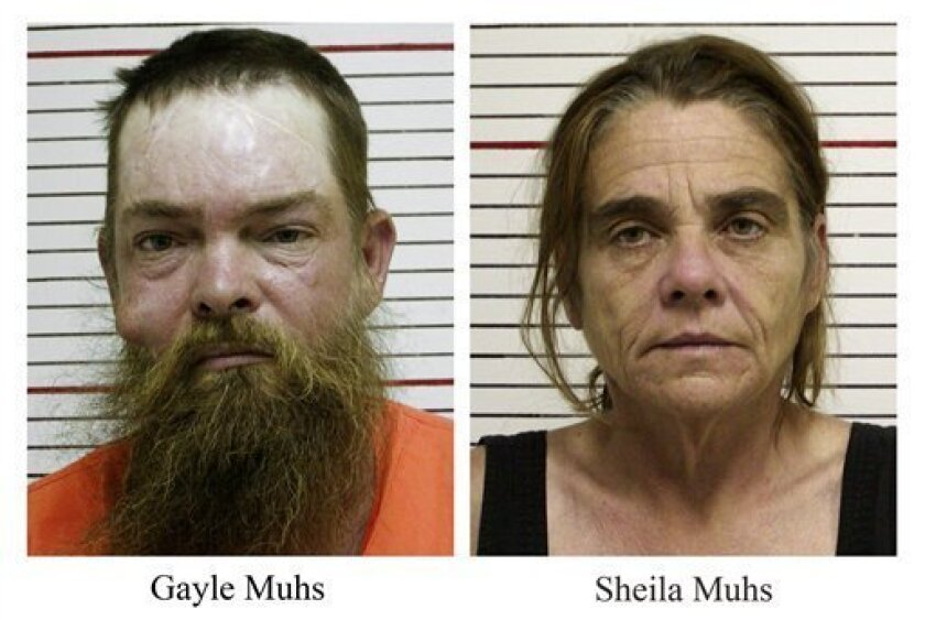 These May 7, 2009 booking photos released by the Liberty County, Texas, Sheriff's Office show Gayle and Sheila Muhs who have been charged with shooting four people, including a 7-year-old boy and a 5-year-old girl, who they mistakenly thought were trespassing on their property Thursday night. The victims were off-roading near Dayton, Texas, when the couple opened fire, according to officials. (AP Photo/Liberty County Sheriff's Office)