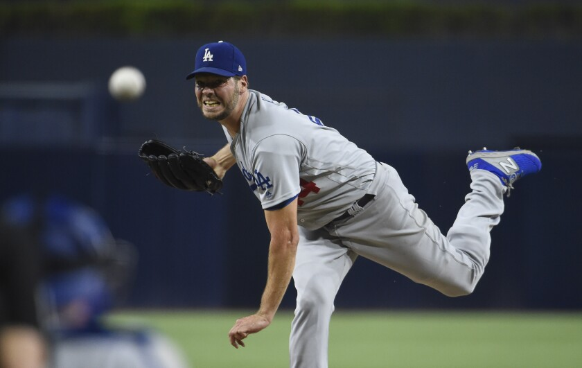 Dodgers' Rich Hill delivers a pitch against the Padres.
