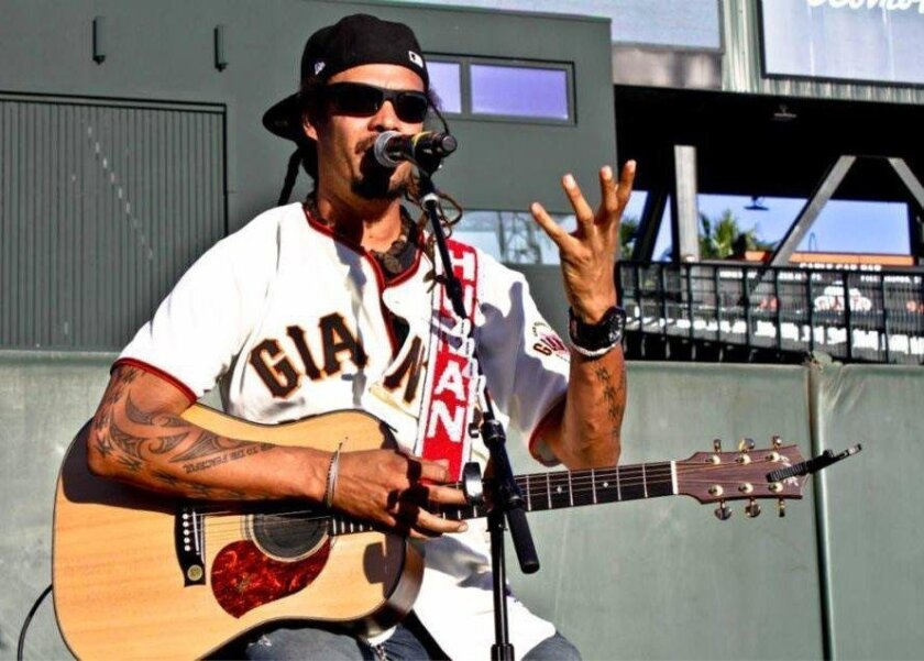 Michael Franti performs during the San Francisco Giants' Yoga Day in 2014.