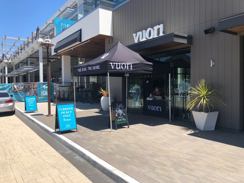 Curbside pick-up is set up at Vuori in Del Mar Highlands Town Center.