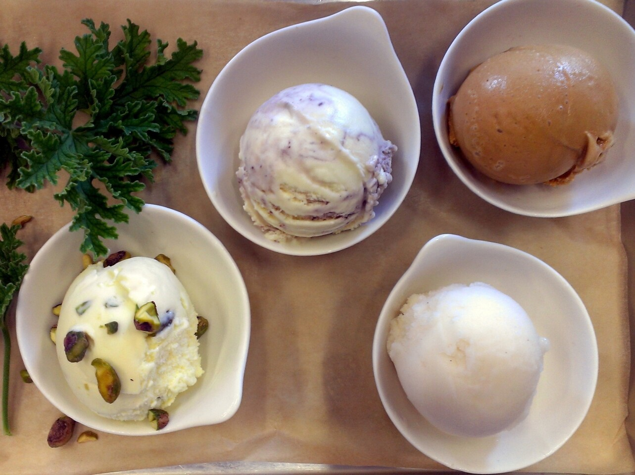 A few of the ice cream flavors at the Sweet Rose Creamery in Santa Monica, from left, include: rose geranium with salty pistachio; creme fraiche with elderberry and pink peppercorn swirl; salted caramel; and pear Riesling sorbet.