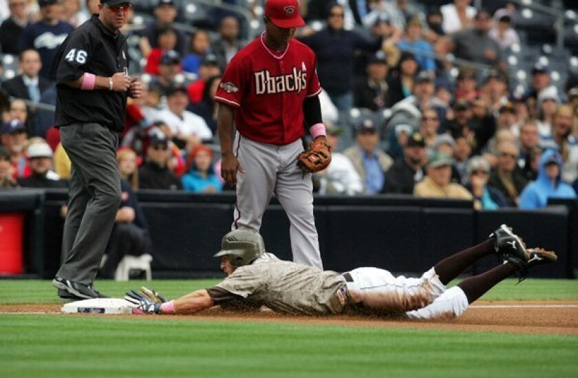 Padres Chris Denorfia dives into 3rd after stealing second and a throwing error by the Diamond Backs in the 1st inning.