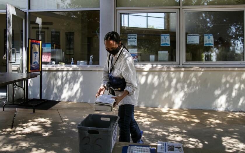 Bronwen Serna returns books to the Los Feliz branch of the Los Angeles Public Library.