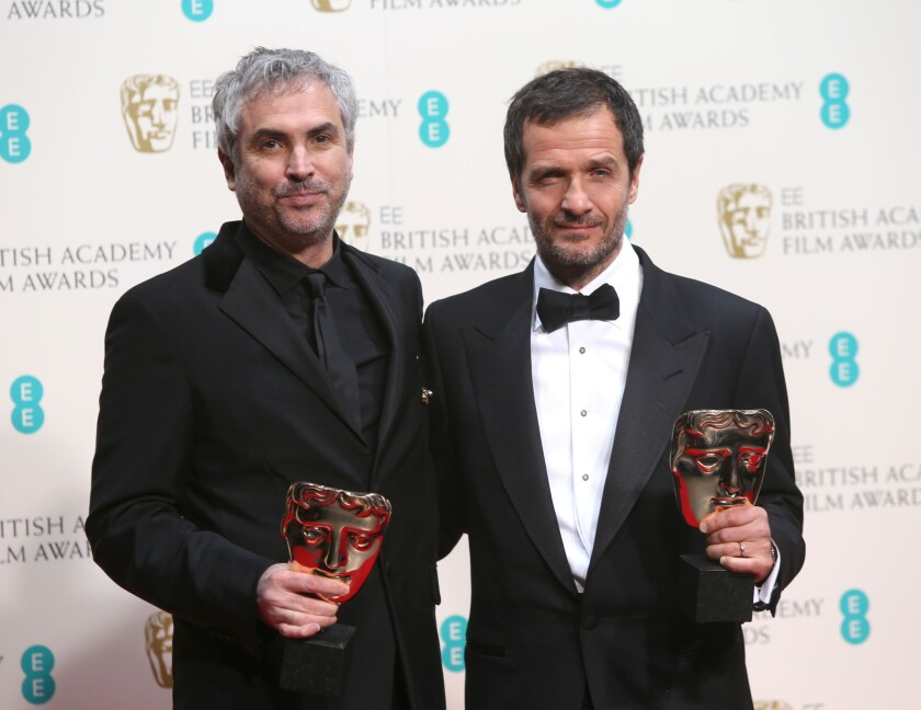 """Gravity"" producers Alfonso Cuarón and David Heyman at the British Academy of Film and Television Arts Awards."