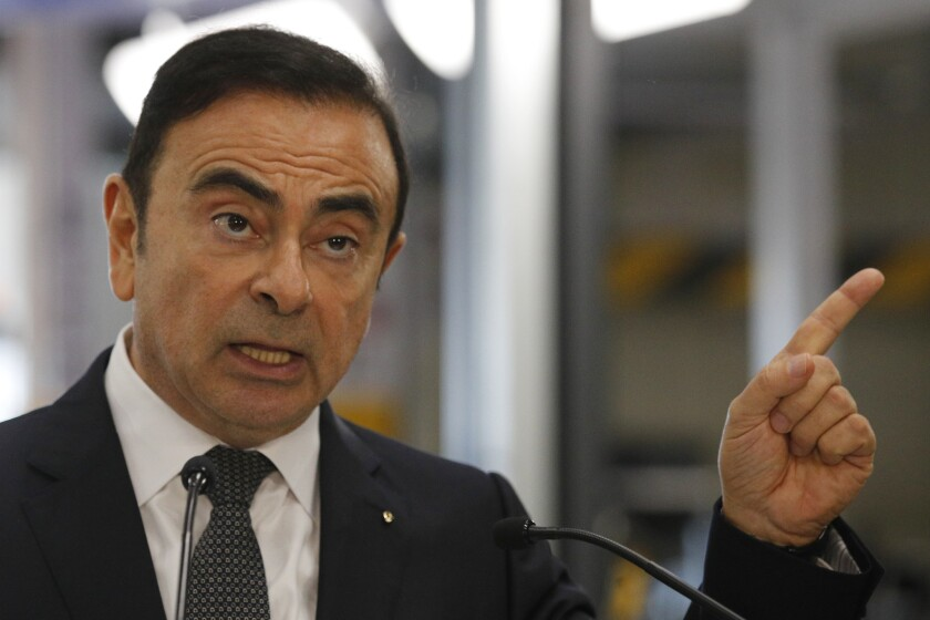 Renault CEO Carlos Ghosn speaks during a visit of French President Emmanuel Macron inside the French
