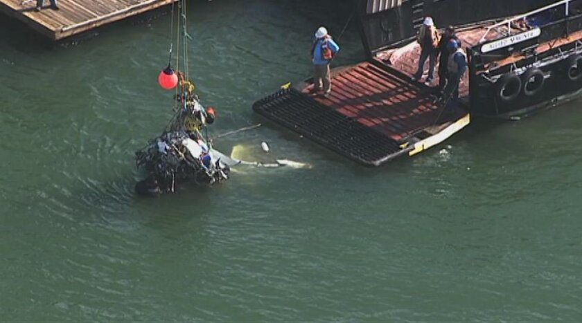 This image provided by KTVU-TV shows search efforts revealing part of a plane Wednesday April 30, 2014 in the San Francisco Bay in San Francisco. Searchers on Monday located the Cessna under 13 feet of water about 1 1/2 miles off the Richmond shoreline east of San Francisco. (AP Photo/KTVU)