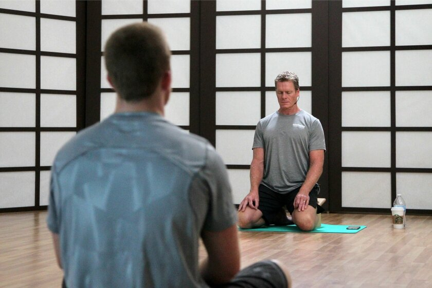 Mark Divine gives instruction during an early morning workout class. / photo by Charlie Neuman * U-T
