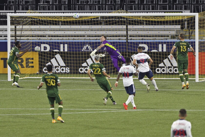 Portland Timbers goalkeeper Steve Clark makes a save against the Vancouver Whitecaps during an MLS soccer match, Sunday, Sept. 27, 2020, in Portland, Ore. (Sean Meagher/The Oregonian via AP)