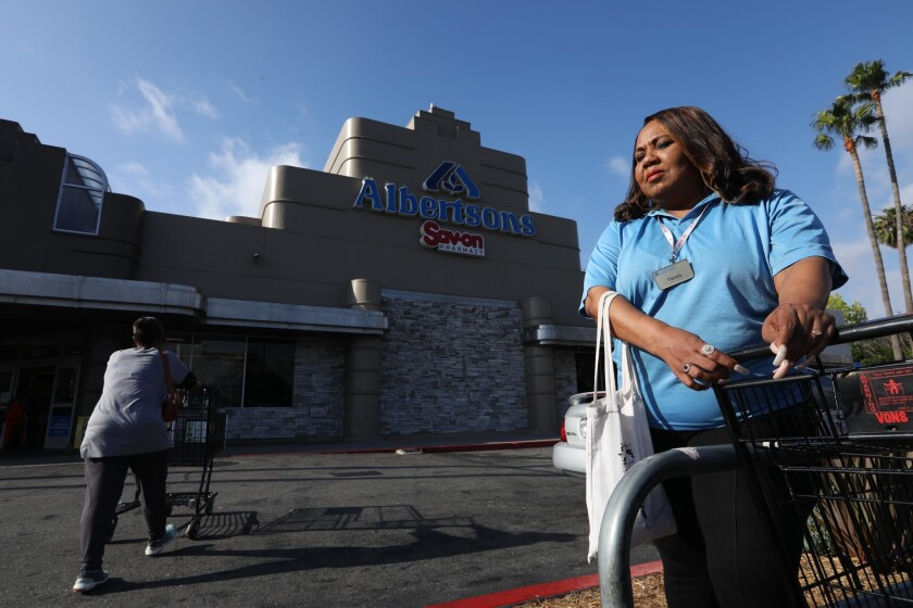 Albertsons cashier Pamela Hill, shown Thursday outside her store on Crenshaw Boulevard in Los Angeles, says she's ready to strike if supermarket and union leaders can't reach a new contract. Genaro Molina / Los Angeles Times