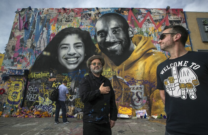 """Artist Thierry """"Mr. Brainwash"""" Guetta, left, and Mike Asner, creator of the KobeMural website, stand in front of a Kobe mural"""