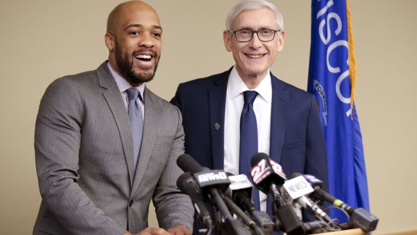 FILE - In this Jan. 3, 2019 file photo, Wisconsin Lt Gov-elect Mandela Barnes, left, and Democratic