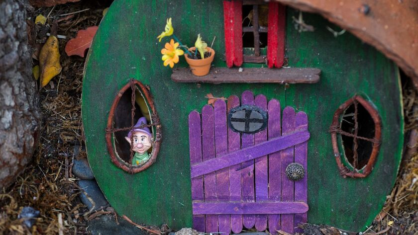 LOS ANGELESA gnome inside a small wooden house is just one the details in Rita Tateel's whimsical fairy and gnome garden in front of her home.