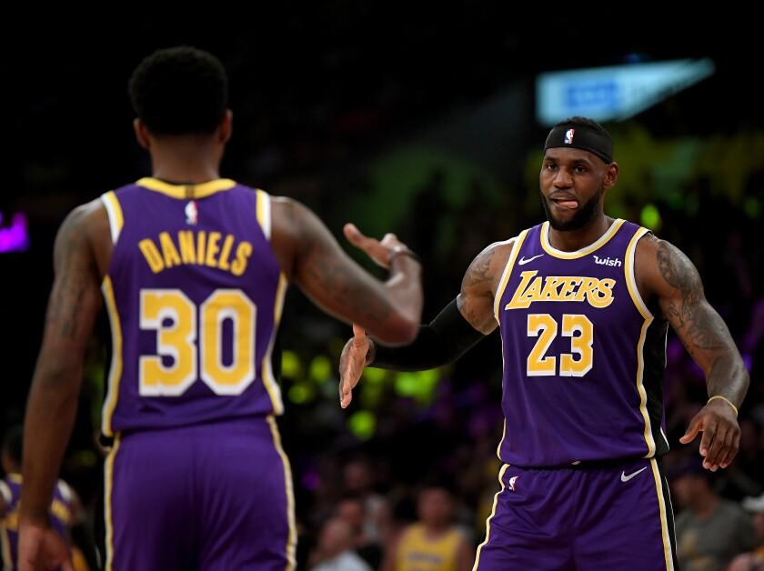 Lakers guard Troy Daniels, left, celebrates with teammate LeBron James after making a three-pointer during a win over the Utah Jazz on Friday.