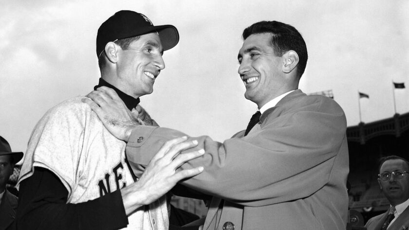 Bobby Thomson, left, and Ralph Branca clown around for the cameras a week after Thomson's famous home run off of Branca.