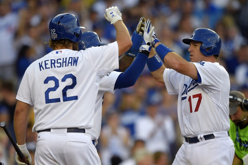 Dodgers' A.J. Ellis, right, celebrates his two-run home run with teammates Carl Crawford and Clayton Kershaw during Game 1 of a National League division series against the St. Louis Cardinals on Oct. 3.