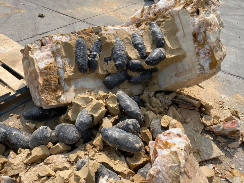 Methamphetamine and cocaine, wrapped in electrical tape, cemented inside quartz boulders, at Customs Monday in Tecate.