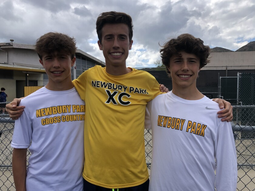 Newbury Park distance standout Nico Young (center) with twin brothers Lex (left) and Leo.