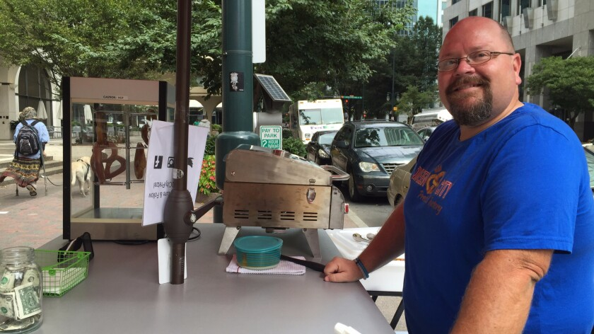 Downtown pretzel vendor Reed Goe worries the state's political tensions will continue.