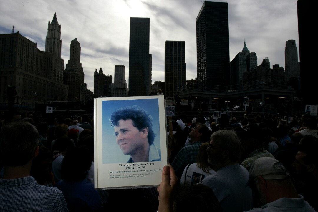 A picture of a man is held among a crowd