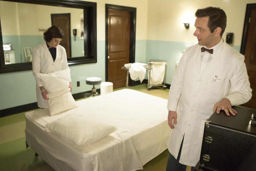 """Lizzy Caplan as Virginia Johnson and Michael Sheen as Dr. William Masters in Showtime's """"Masters of Sex."""""""