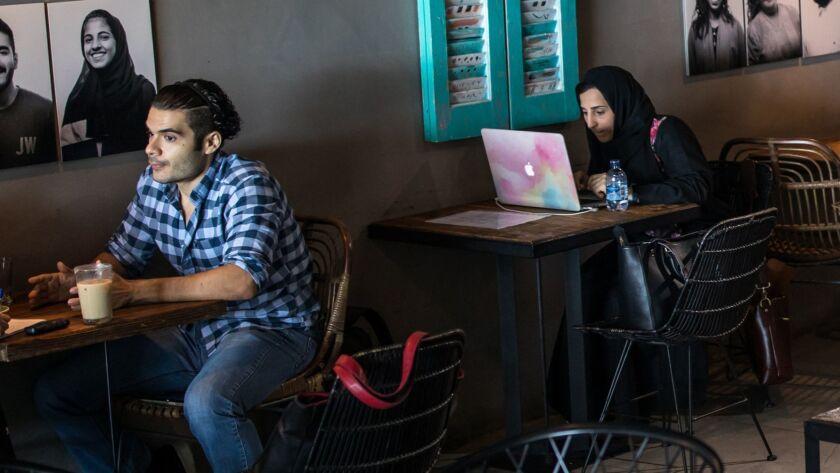 Hakeem Jomah, left, working at Medd cafe in Jedda.