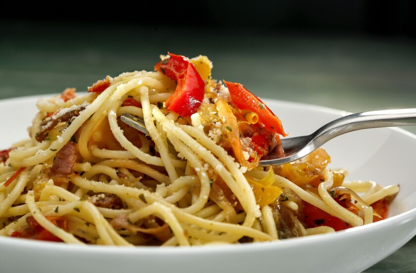 Spaghetti with wilted peppers