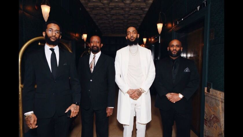 Samiel Asghedom, left, Dawit Asghedom, Ermias Asghedom, a.k.a. Nipsey Hussle, and Adam Andebrhan shortly before the Grammys in 2019.