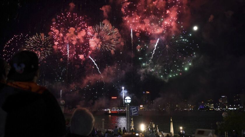 More than 100,000 explosives light up the sky in downtown Detroit's Hart Plaza over the Detroit Rive