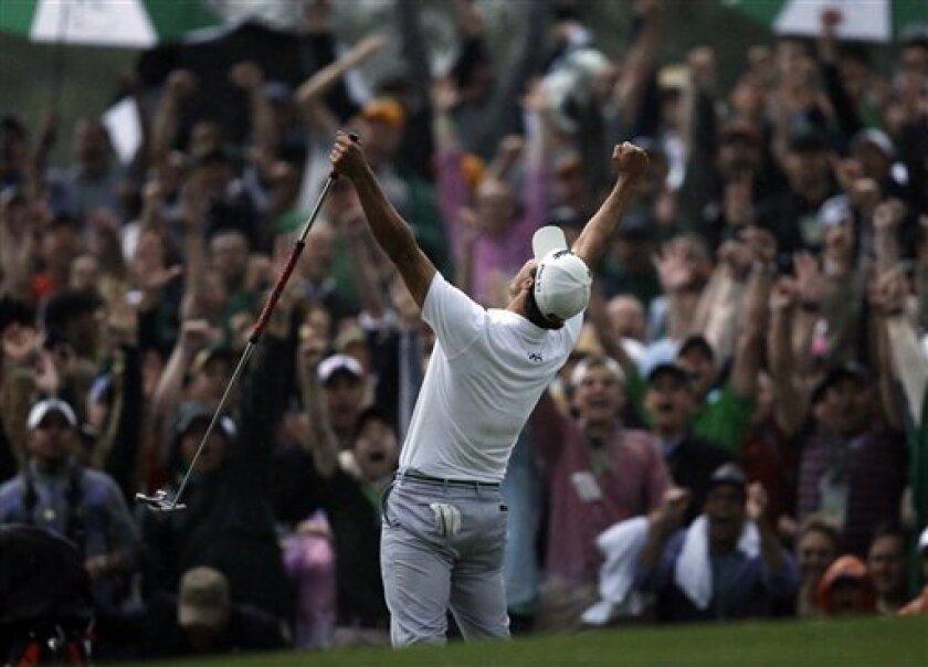 Adam Scott, of Australia, celebrates after making a birdie putt on the second playoff hole to win the Masters golf tournament Sunday, April 14, 2013, in Augusta, Ga. (AP Photo/Matt Slocum)