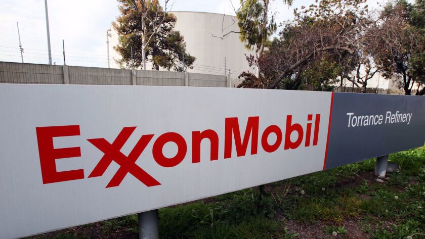 A photo taken Jan. 30, 2012, shows the sign outside an oil refinery facility in Torrance, Calif. that until this year was owned by Exxon Mobil. The plant was sold for $537.5-million to New Jersey-based PBF Energy.