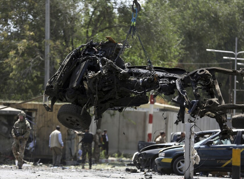 File- in this Thursday, Sept. 5, 2019. Photo, Resolute Support (RS) forces remove a destroyed vehicle after a car bomb explosion in Kabul, Afghanistan. An American service member was killed in action on Monday in Afghanistan the U.S. military said in a statement without providing more details. (AP Photo/Rahmat Gul, file)
