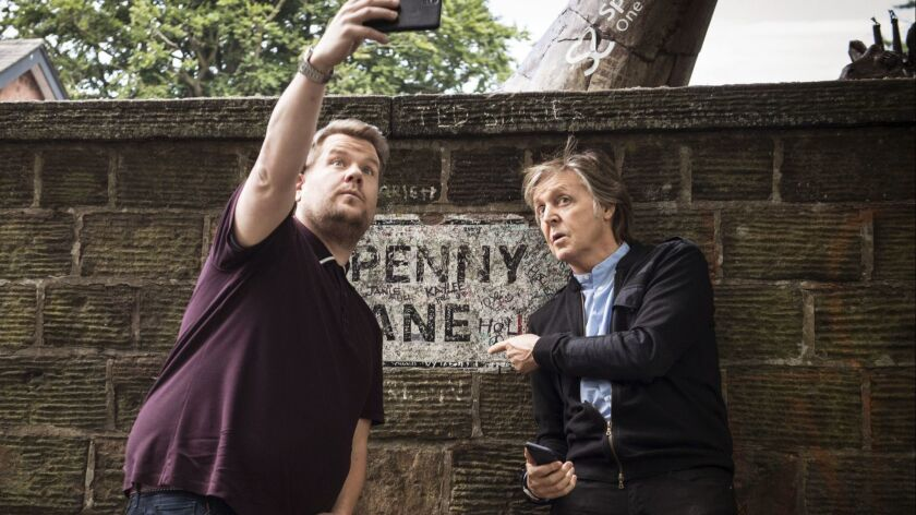 In this image released by CBS, Paul McCartney, right, joins host James Corden as they take a selfie