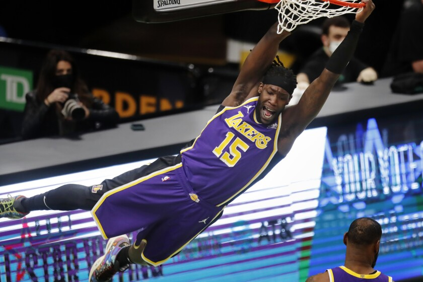 Lakers forward Montrezl Harrell hangs from the rim after a dunk in the second quarter.