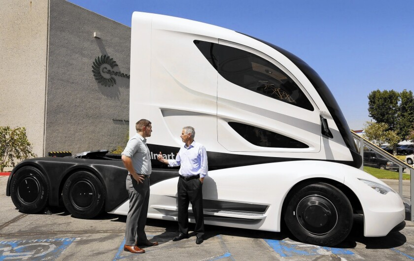 A futuristic hybrid-electric tractor-trailer concept truck is parked outside the Capstone Turbine facility in Chatsworth.