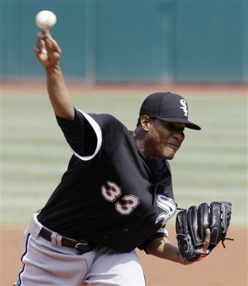 Chicago White Sox starting pitcher Edwin Jackson (33) pitches to the Cleveland Indians during the third inning of a baseball game, Saturday, April 2, 2011, in Cleveland. (AP Photo/Tony Dejak)