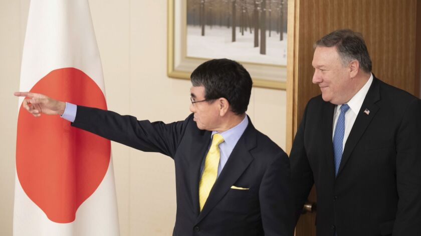 U.S. Secretary of State Mike Pompeo, right, meets with Japan's Foreign Minister Taro Kono at the Foreign Ministry in Tokyo on Saturday.