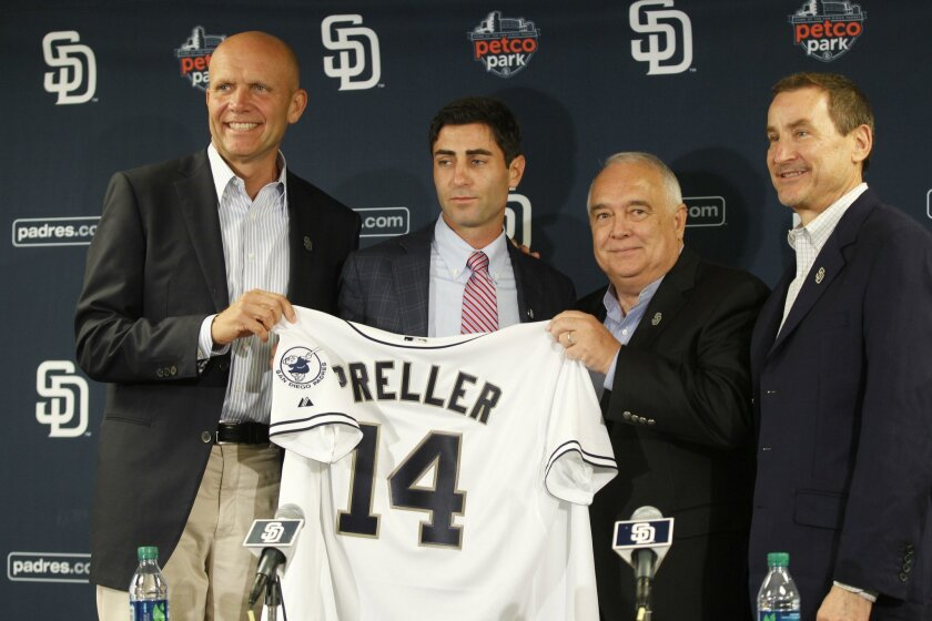 The Padres announced A.J. Preller, second from left, was named executive vice president/general manager in August 2014. From left are Padres President & CEO Mike Dee, left, Padres Chairman Ron Fowler and lead investor Peter Seidler.