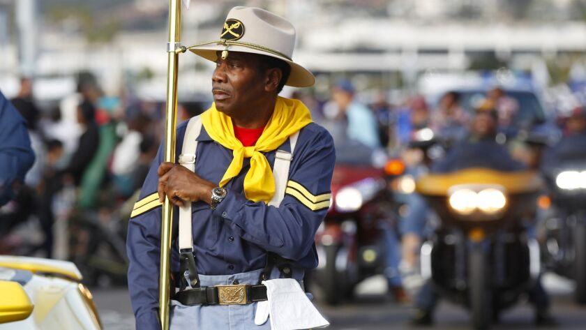 Johnny Grayson walks the San Diego Chapter of the Buffalo Soldiers in the 2018 Martin Luther King Jr. Parade along Harbor Drive in San Diego.