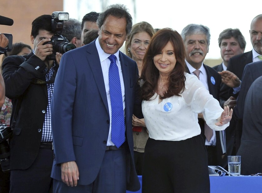 Argentine President Cristina Fernandez de Kirchner and Daniel Scioli, governor of Buenos Aires province, pose for a photo during a visit last week to a nuclear power plant.