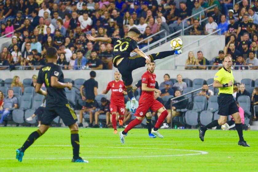 LAFC midfielder Eduardo Atuesta controls the ball in mid-air.