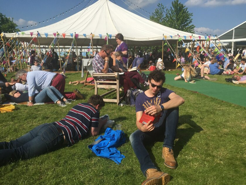 People at the Hay festival enjoy the weather as they attend the Hay Festival in Hay on Wye Wales . With three weeks before they vote on whether to quit the European Union one question _ should we stay or should we go _ is dominating this year's Hay Festival, an 11-day celebration of books and ideas