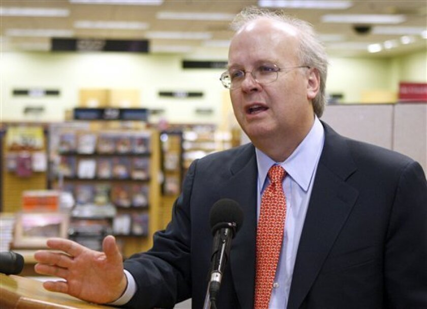 FILE - In this May 17, 2010 file photo, former White House adviser Karl Rove gestures in Oklahoma City, Okla. (AP Photo/Sue Ogrocki, File)
