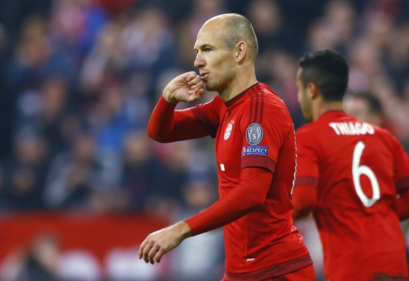 Bayern's Arjen Robben celebrates after scoring his side's fourth goal during the Champions League Group F soccer match between Bayern Munich and Arsenal FC in Munich, southern Germany, Wednesday, Nov. 4, 2015. (AP Photo/Matthias Schrader)