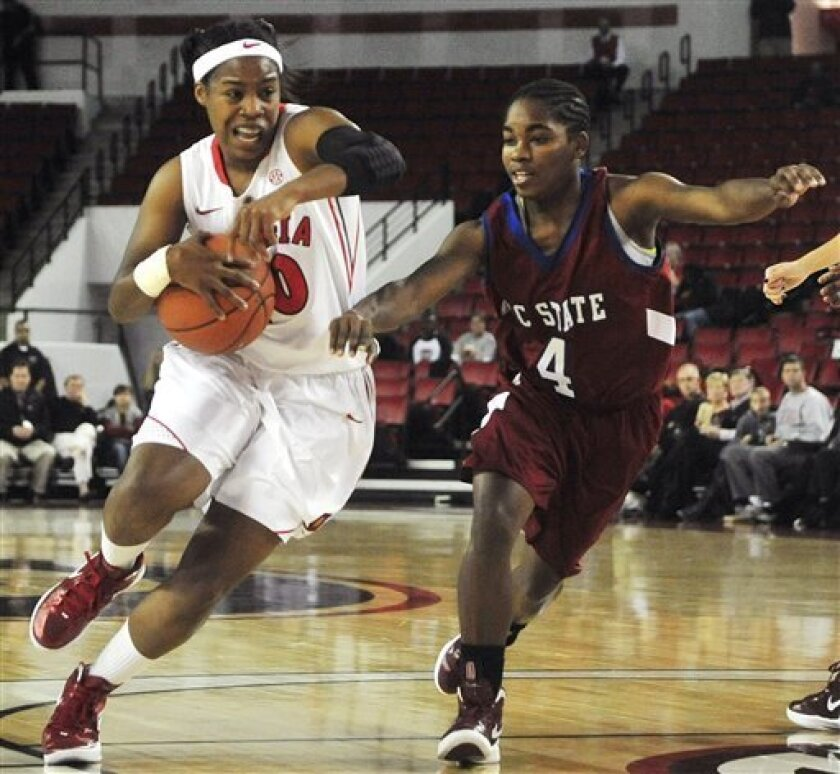 Georgia guard Jasmine James (10) is pressured by South Carolina State guard Cabriel Duren (4) as she drives to the basket in the first half of an NCAA college basketball game, Wednesday, Nov. 30, 2011, in Athens, Ga. (AP Photo/Richard Hamm)
